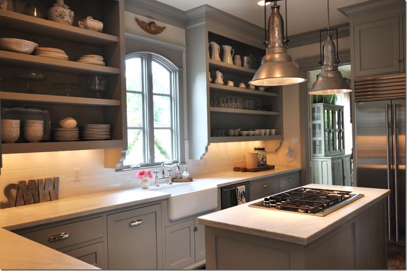 grey open cabinets, island, light fixtures.