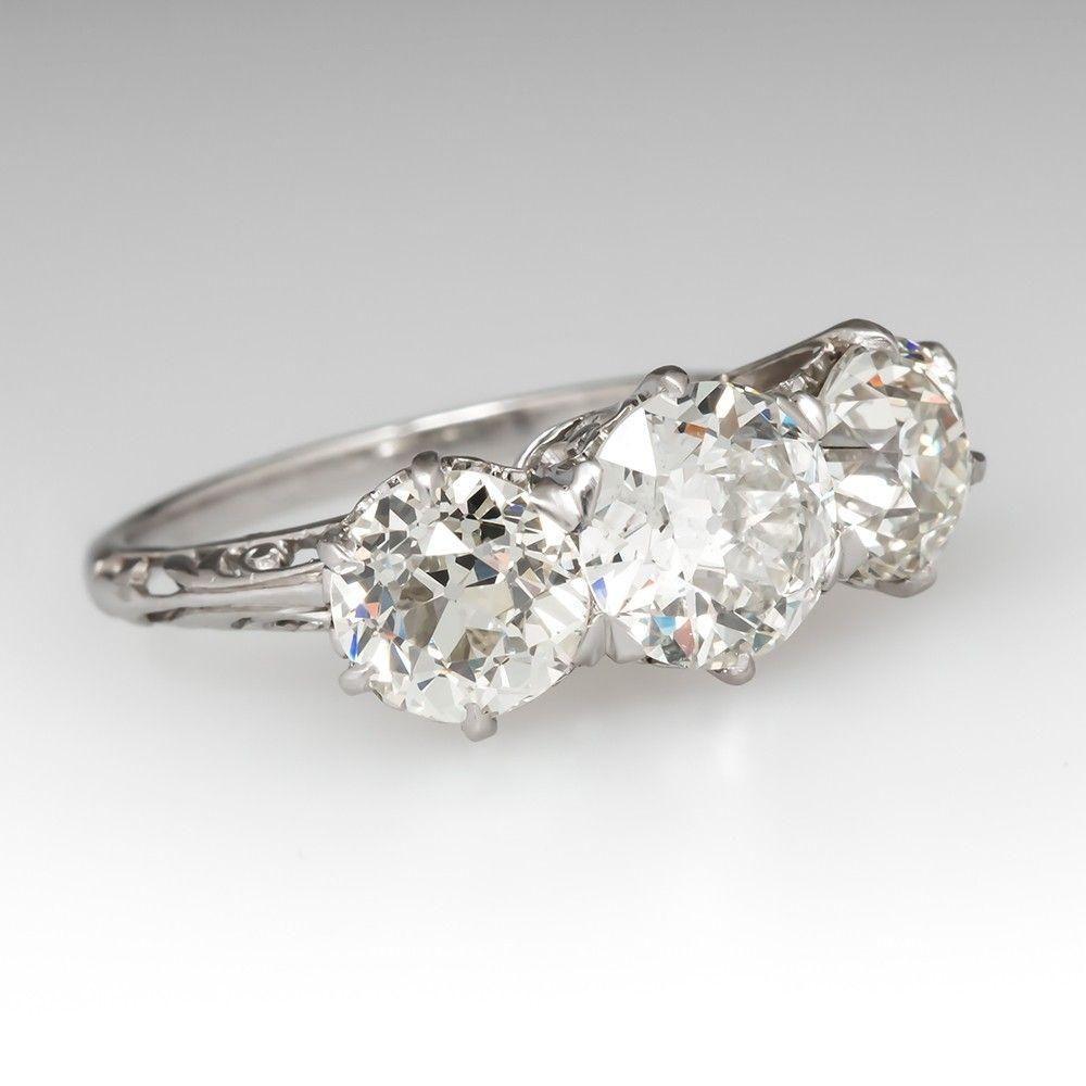 This Intricate 1920 S Antique Three Stone Diamond Engagement Ring Displays Its Three Stone Diamond Rings Engagement Vintage Bracelets Vintage Engagement Rings