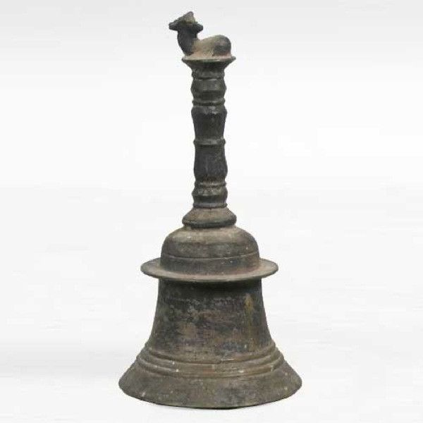 Indian Hindu Ritual Bronze Bell (Ghanta)  This traditional, ceremonial hand held ghanta (bell) is topped by the Hindu mythological bull, Nandi, the mount of the god Shiva. The handle is ring and baluster turned on a waisted bell with a wide lip shoulder and ring decoration. 19th century