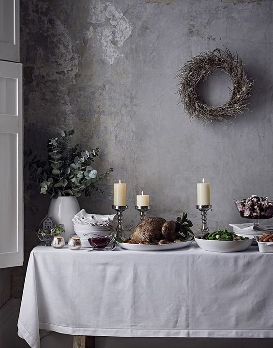 Image of full Christmas dinner laid out on a side table, styled by Mary Norden for The White Company #christmas #christmasdinner #festive #thewhitecompany #whitecompany #jondayphotography #interiors #interiorphotography #jonday #marynorden #marynordeninteriorstylist #turkey #interiorstrend #xmas #decorations #christmasdecorations #christmasturkey #food #foodphotography #garland #wreath #christmasdiningroom #christmascandles #christmasroastdinner #traditionalchristmas #stylishchristmas
