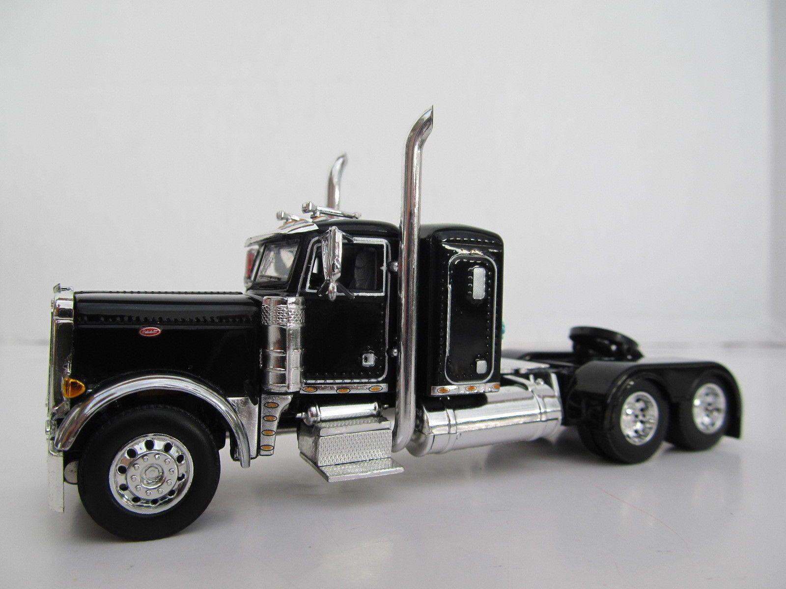 DCP 1//64 SCALE W900 KENWORTH FLAT TOP BLACK WITH WHITE SEMINOLE STRIPE