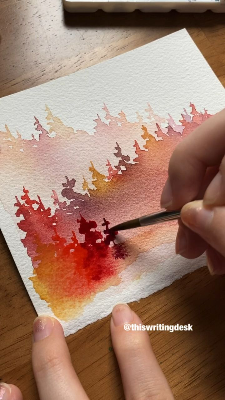 Painting watercolor pine trees