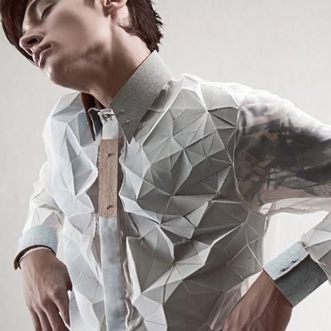 Yung Wong's SS14 Menswear Collection. Origami shirts that are crystallized into futuristic forms, enhanced by detailing in unexpected materials like wood.