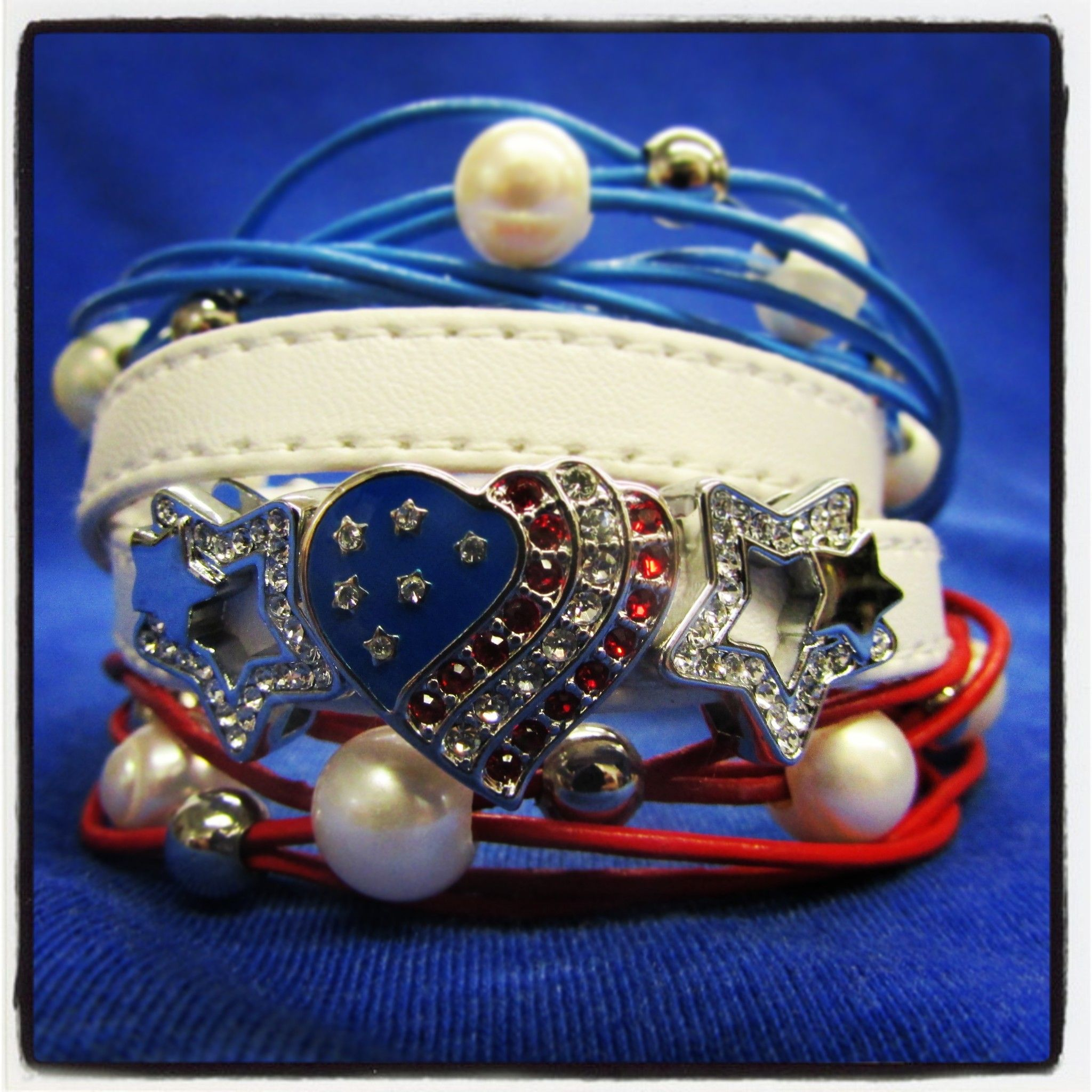 Red, white and blue!! Celebrate the 4th with some super cute accessories #bracelet #heart #charms #stars #vivacious #doublewrap http://www.sugarandvine.com/charms-and-letters/symbols/symbols-american-flag-heart.html