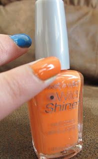 Hot Glue & Sparkle: Wet n Wild LE Pop Art Craze nail polish collection: review and swatches-- The Clock Strikes Orange