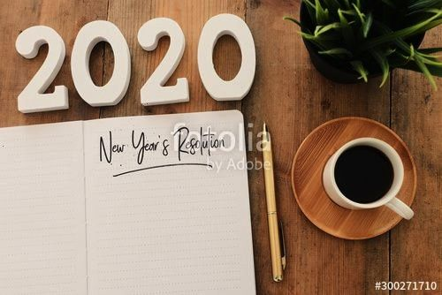 concept of top view 2020 years resolution list with notebook cup of coffee over wooden desk Business concept of top view 2020 years resolution list with notebook cup of c...