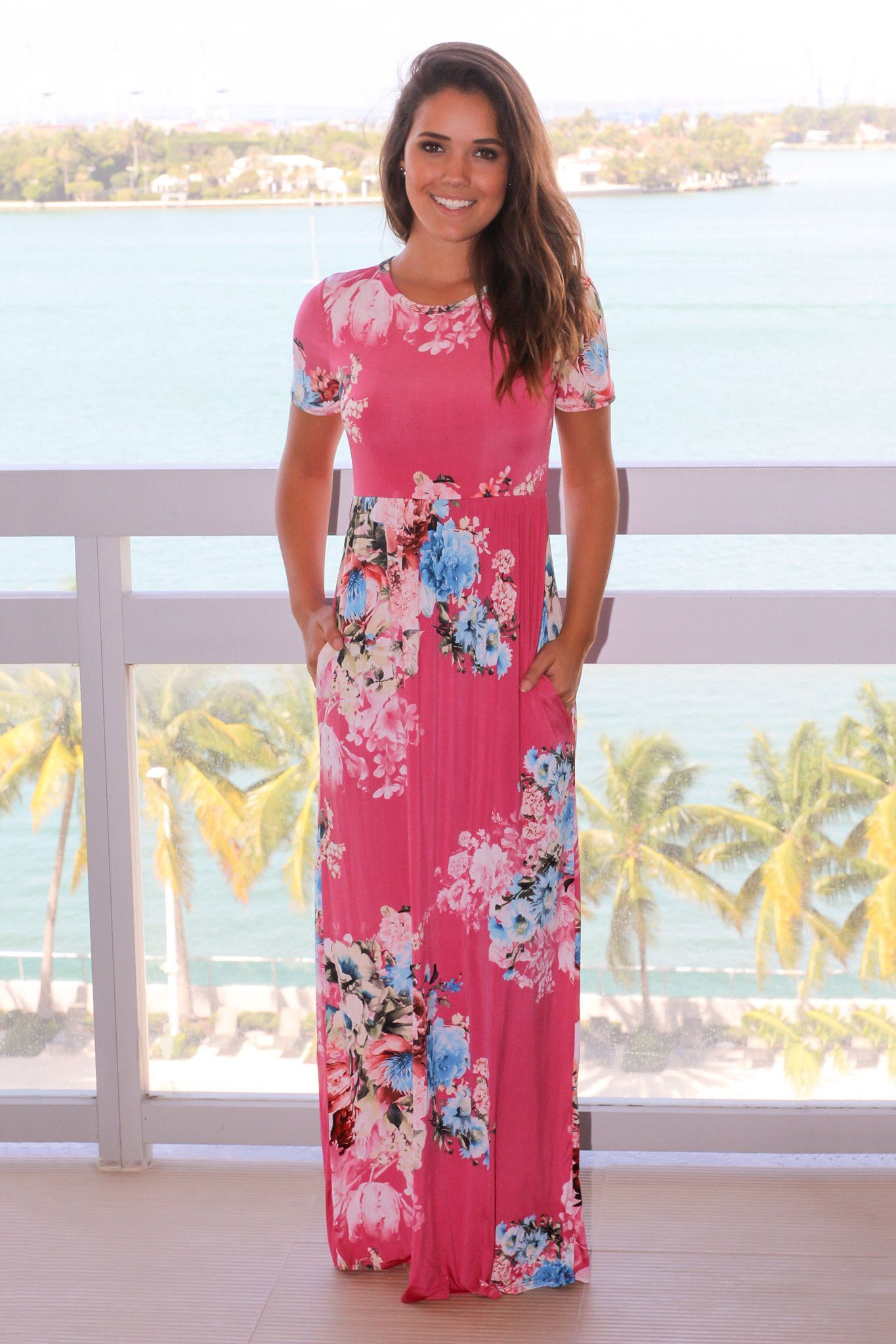 Pink floral maxi dress with short sleeves pink shorts and maxis