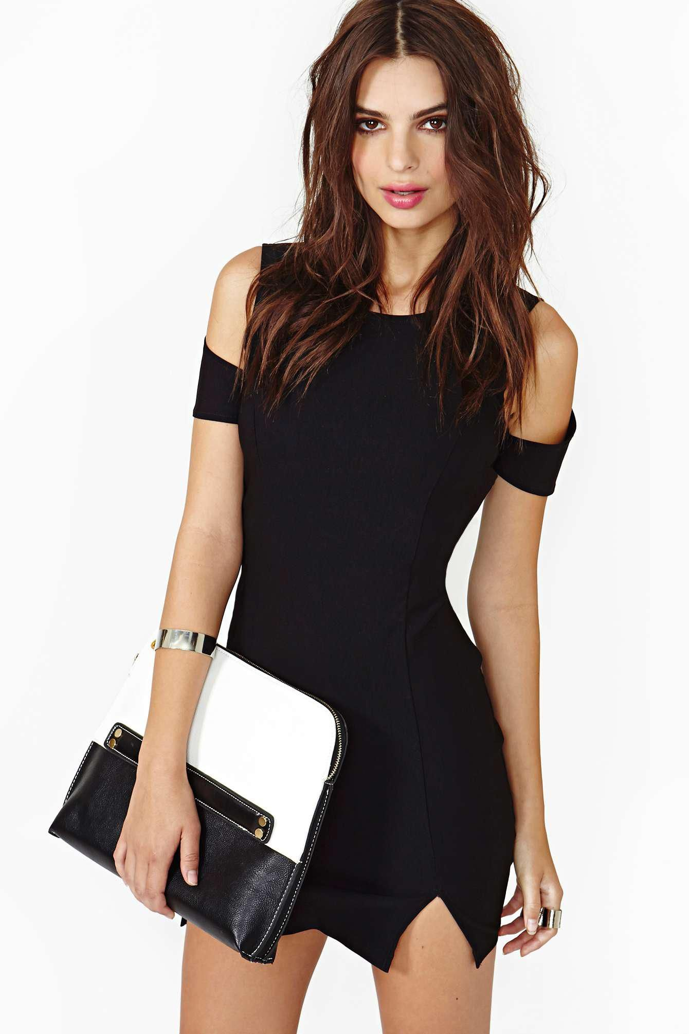Turn up the heat in this killer black bodycon with cutout shoulders