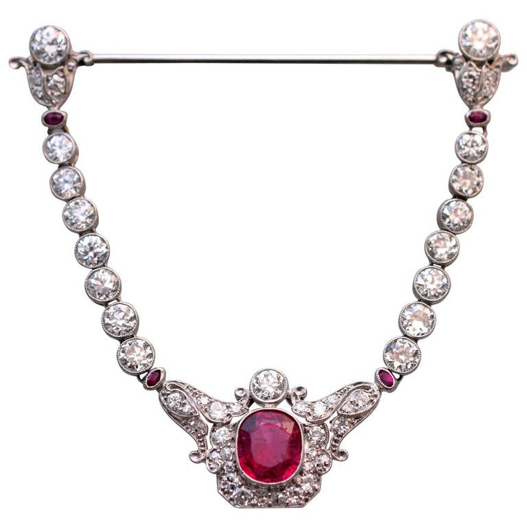 Edwardian Spinel Diamond Jabot Brooch. Edwardian, Spinel and Diamond Jabot Brooch! Beautiful swag design, with a vibrant red color center spinel measuring 8.30x10.64mm Accompanied by A.G.L. identification & origin certificate ( # CS 60131) April 08/2014 4 oval paste & 54 old European cut diamonds