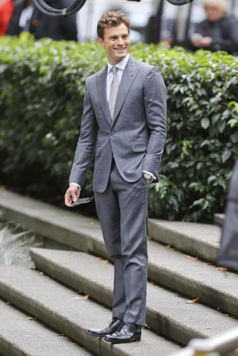 Jamie Dornan wearing Grey Suit, White Dress Shirt, Black Leather ...