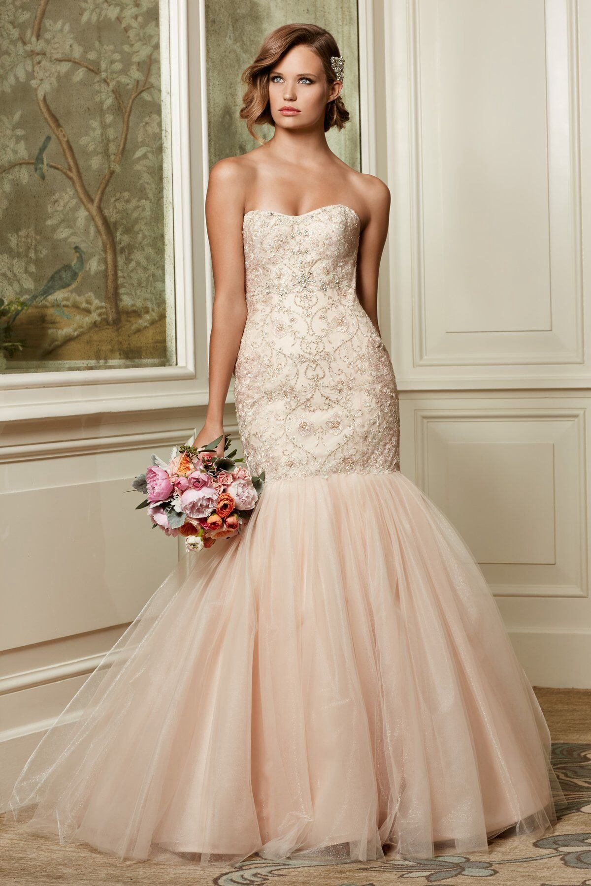 This blush Watters gown is so We love the beaded