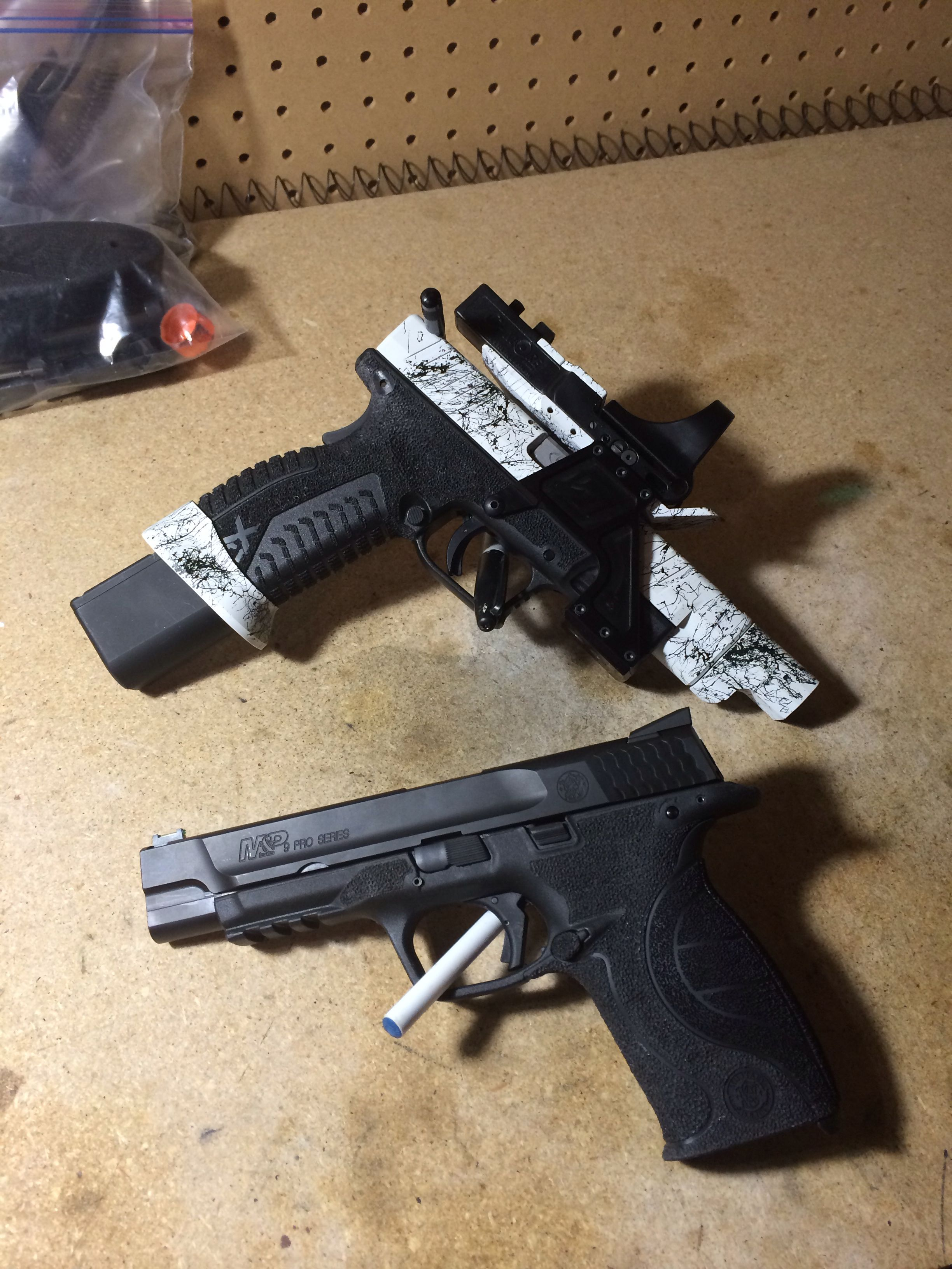 XDm set up for steel challenge and an M&P for the 3 gun tac ops