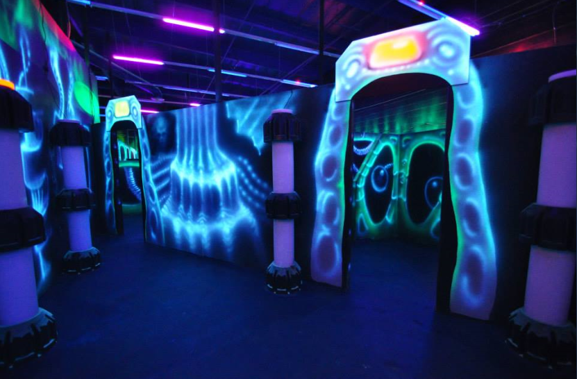 Take Cover In The Hazy Arena Before Tagging The Other Team At Valencia Laser Blast Laser Tag Video Games For Kids Space Party