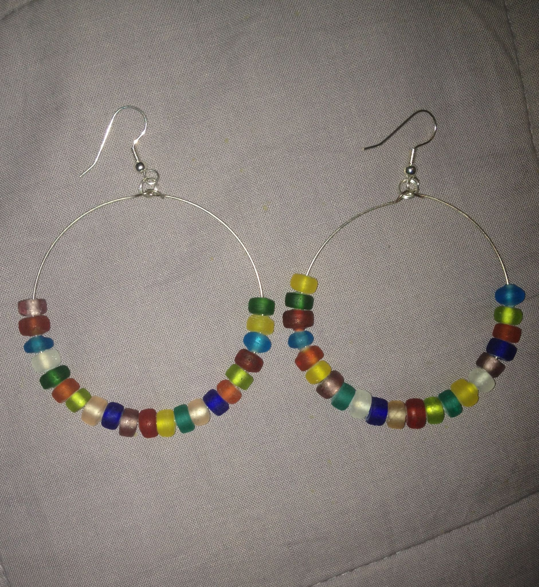 Memory wire earrings with colourful beads made for my sisters hols ...