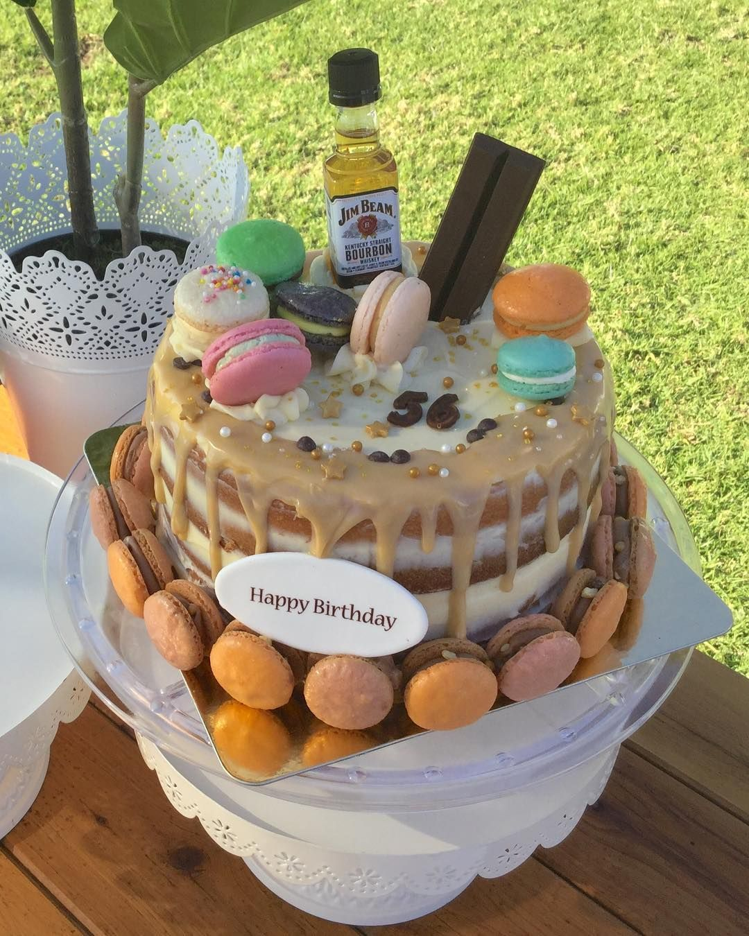 """5 Likes, 1 Comments - Hunter macarons (@hunter_macarons) on Instagram: """"Birthday Cake for 56 years old supper daddy!! Naked drip Sponge Cake with white chocolate…"""""""