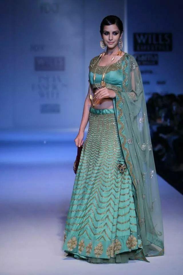 Aqua and gold sari.