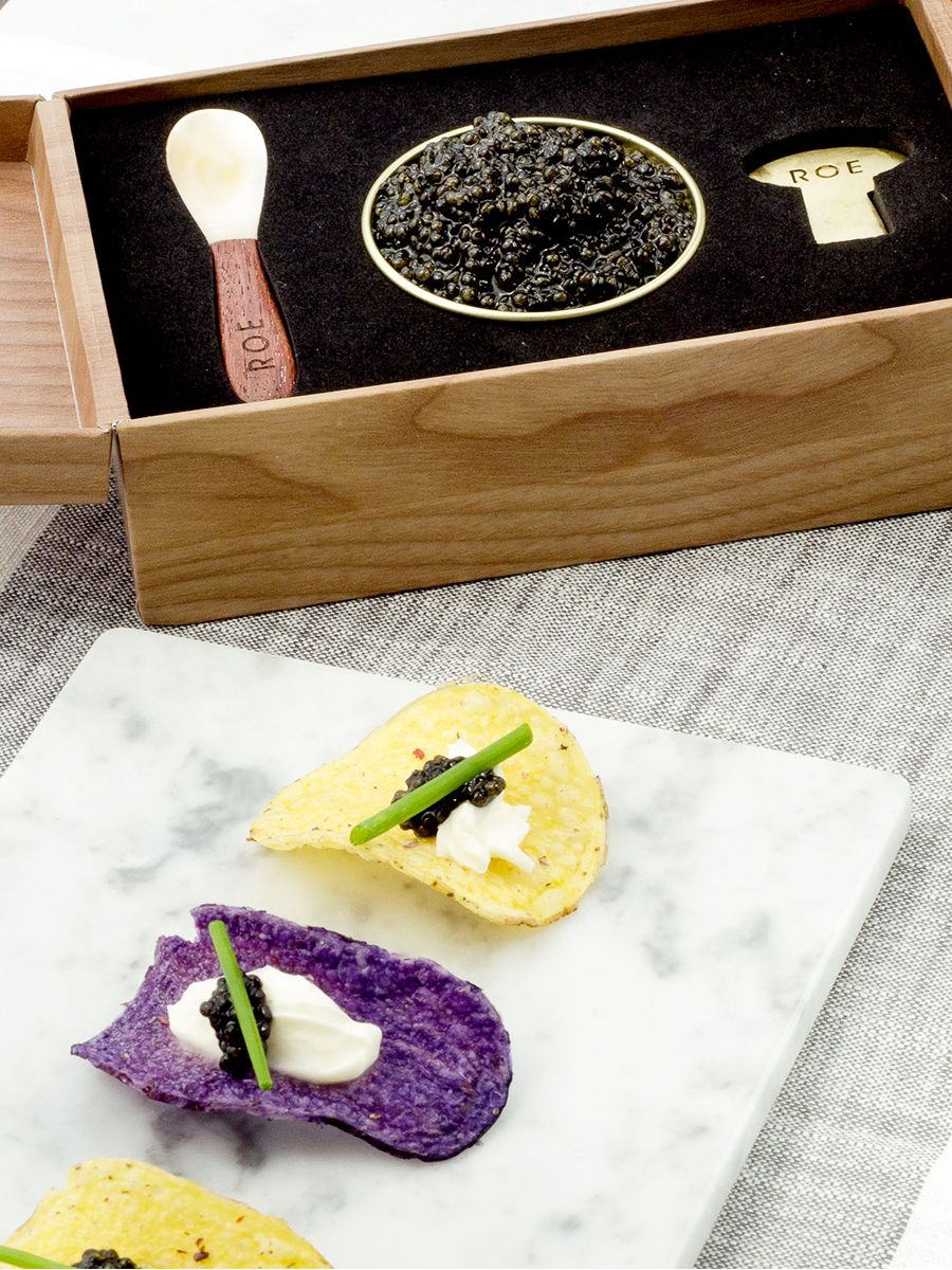 Creme Fraiche and Caviar on Potato Chips—easy, simple, luxurious.