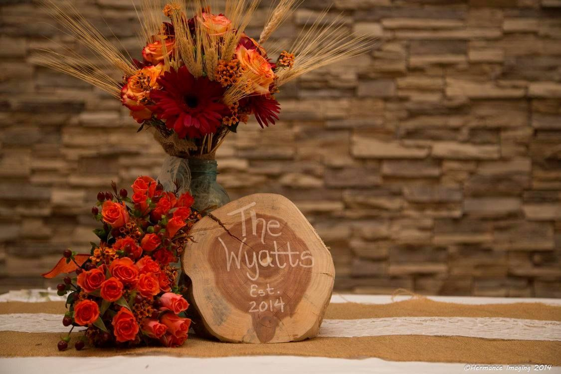 These stunning fall wedding bouquets feature orange roses, wax flower, hypericum berries, wheat and gerber daisies. Designed by Jen-Mor Florist in Dover, Delaware www.jenmor.com