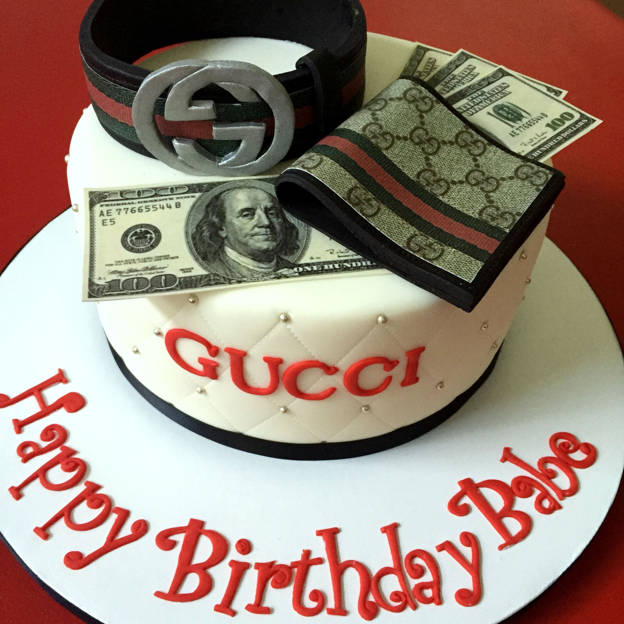 Gucci cake with matching belt and wallet. Made with Cake