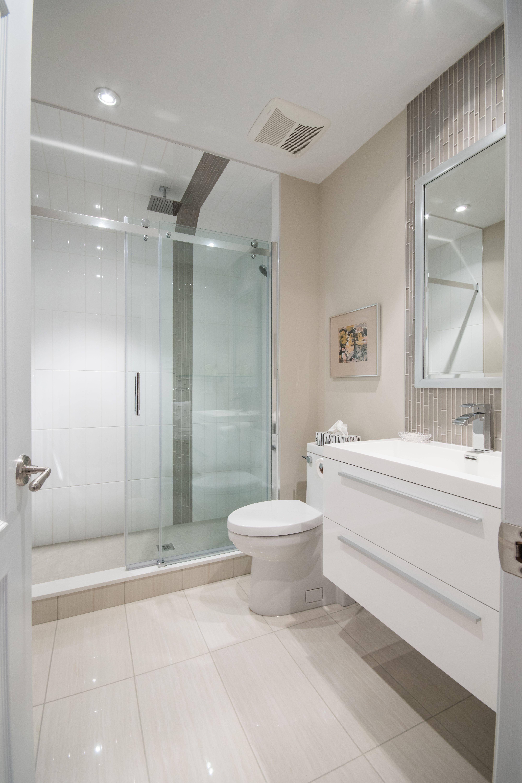 Modern White Grey Guest Washroom Vertical Glass Wall Tile Accent Sliding Sh Bathroom Remodel Small Diy Bathroom Remodel Small Shower Small Bathroom Remodel