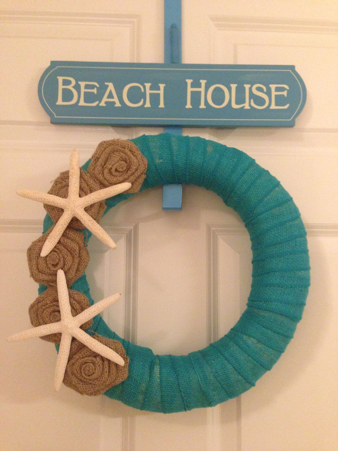 """12"""" Turquoise Jute Wrapped Wreath with Starfish and Handmade Coffee Burlap Flowers.. $40.00, via Etsy."""