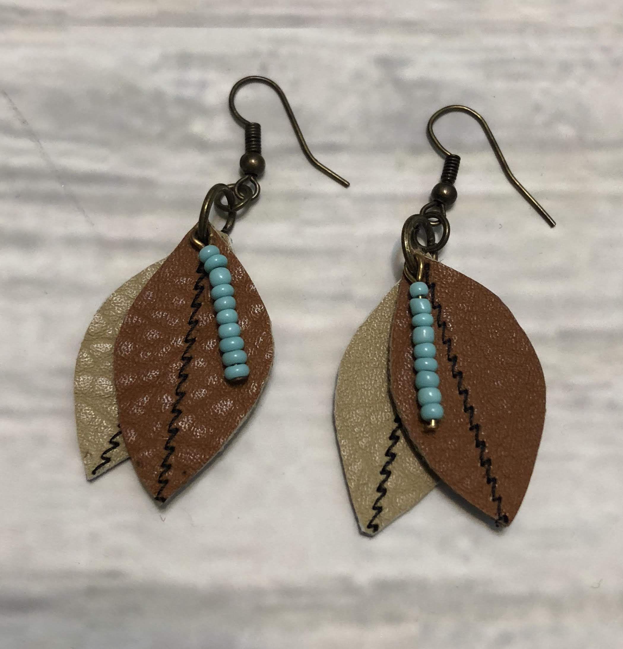 Wood and palm leaf burgundy genuine leather teardrop earrings Handmade by Got You Hooked Designs.