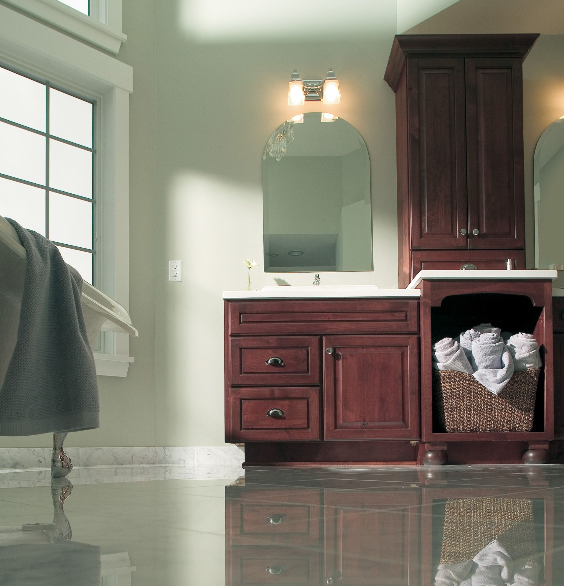 This knotty alder bathroom vanity cabinetry is shown with Dura