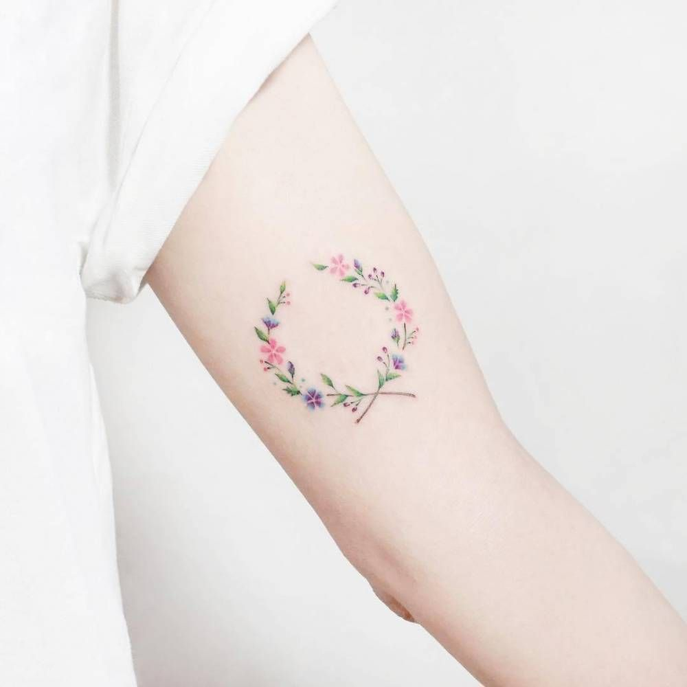 Illustrative Flower Wreath Tattoo On The Left Inner Arm Wreath Tattoo Small Tattoos Little Flower Tattoos