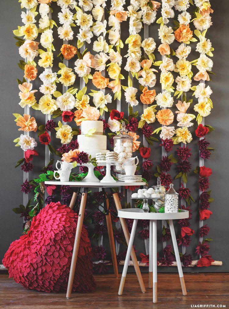 Diy flower wedding backdrop tutorial with crepe blooms