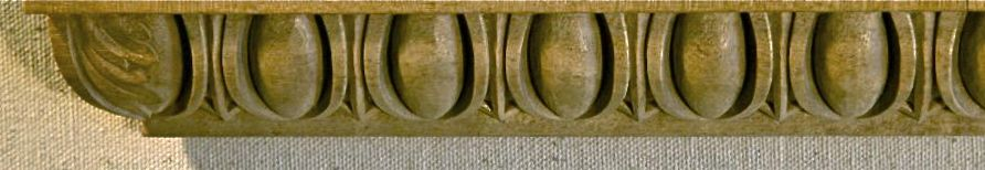Typical egg and dart ovolo molding hand carved in wood - showing the acanthus treatment of the corners