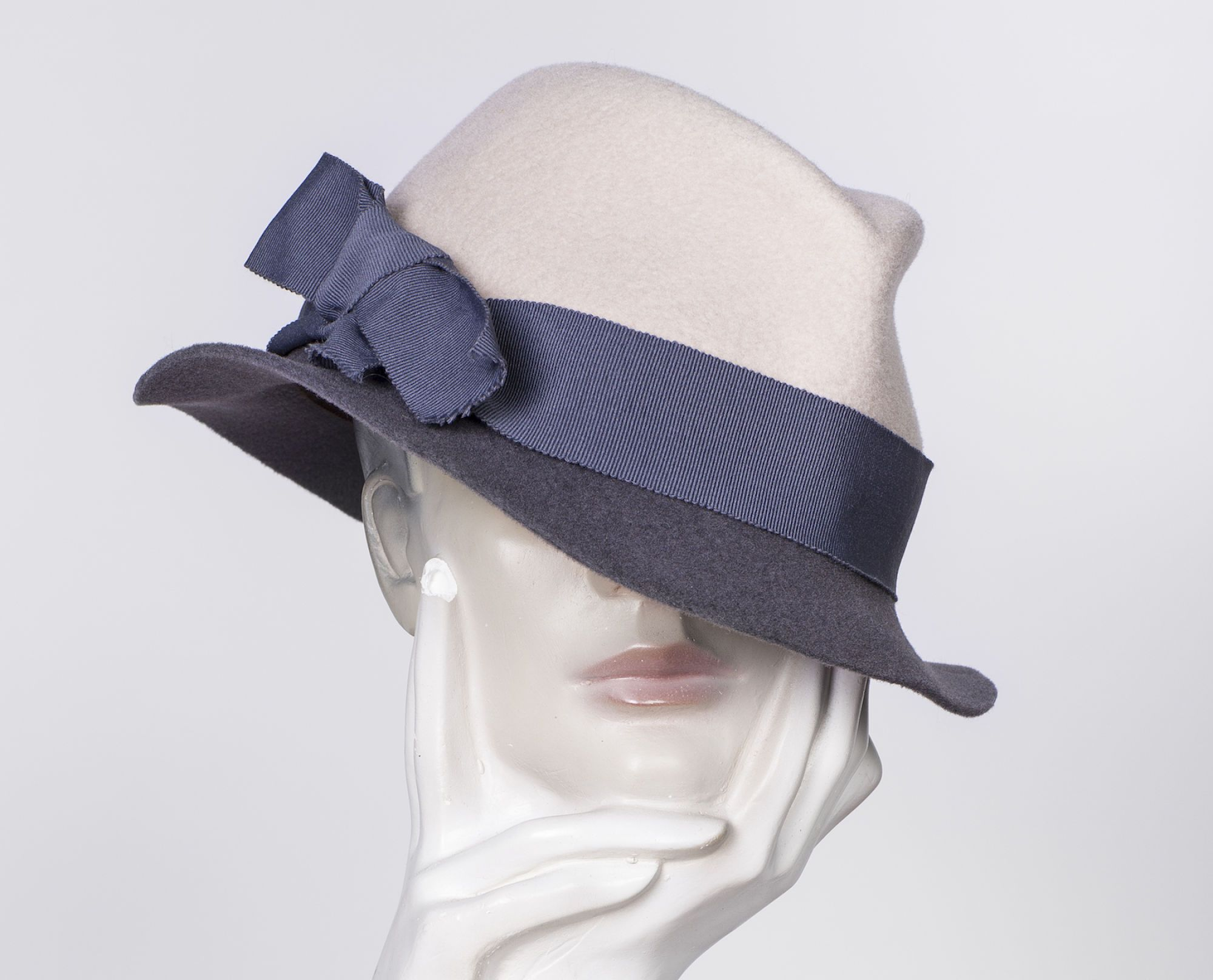 Demure couture hat.  The finest handmade couture hats from Amsterdam. Visit demure at www.demure.nl and get inspired by the latest collections. Only natural materials, locally sourced by a select network of suppliers.  Millinery at it's best.   Feel free to contact Demure to setup an appointment for a studio visit or a personal conversations about your preferred style and fabrics.  www.demure.nl