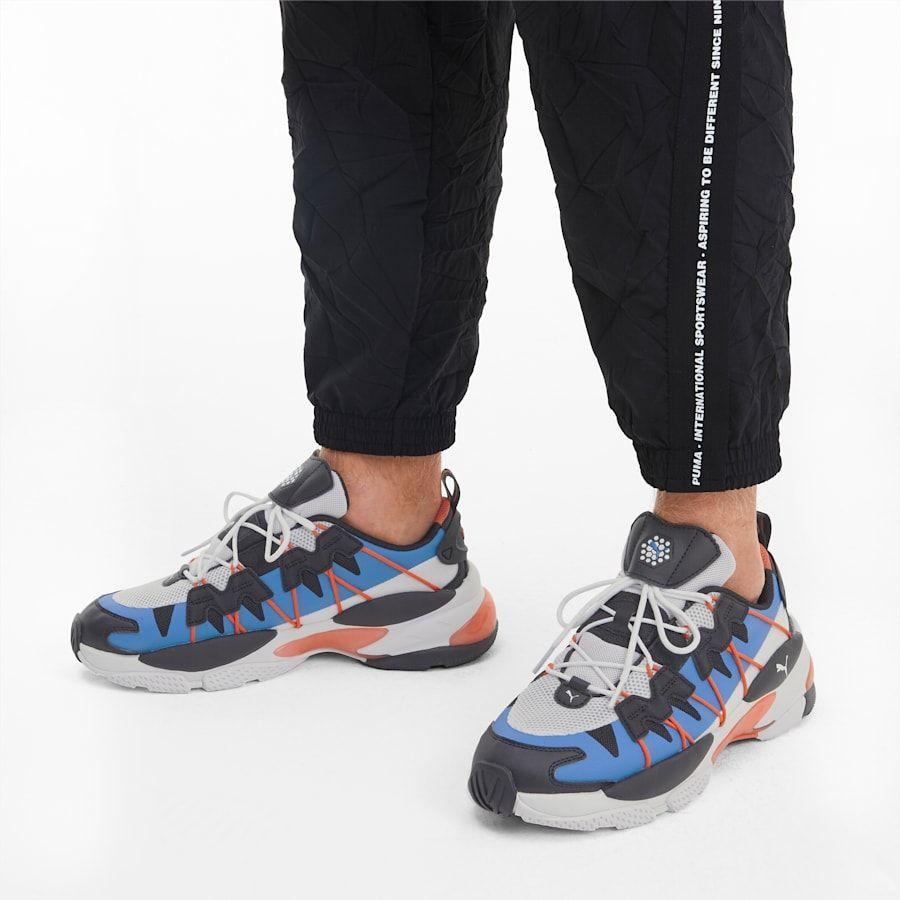 Photo of LQD CELL Omega Striped Kit Trainers   Puma Black-Palace Blue   PUMA Shoes   PUMA United Kingdom