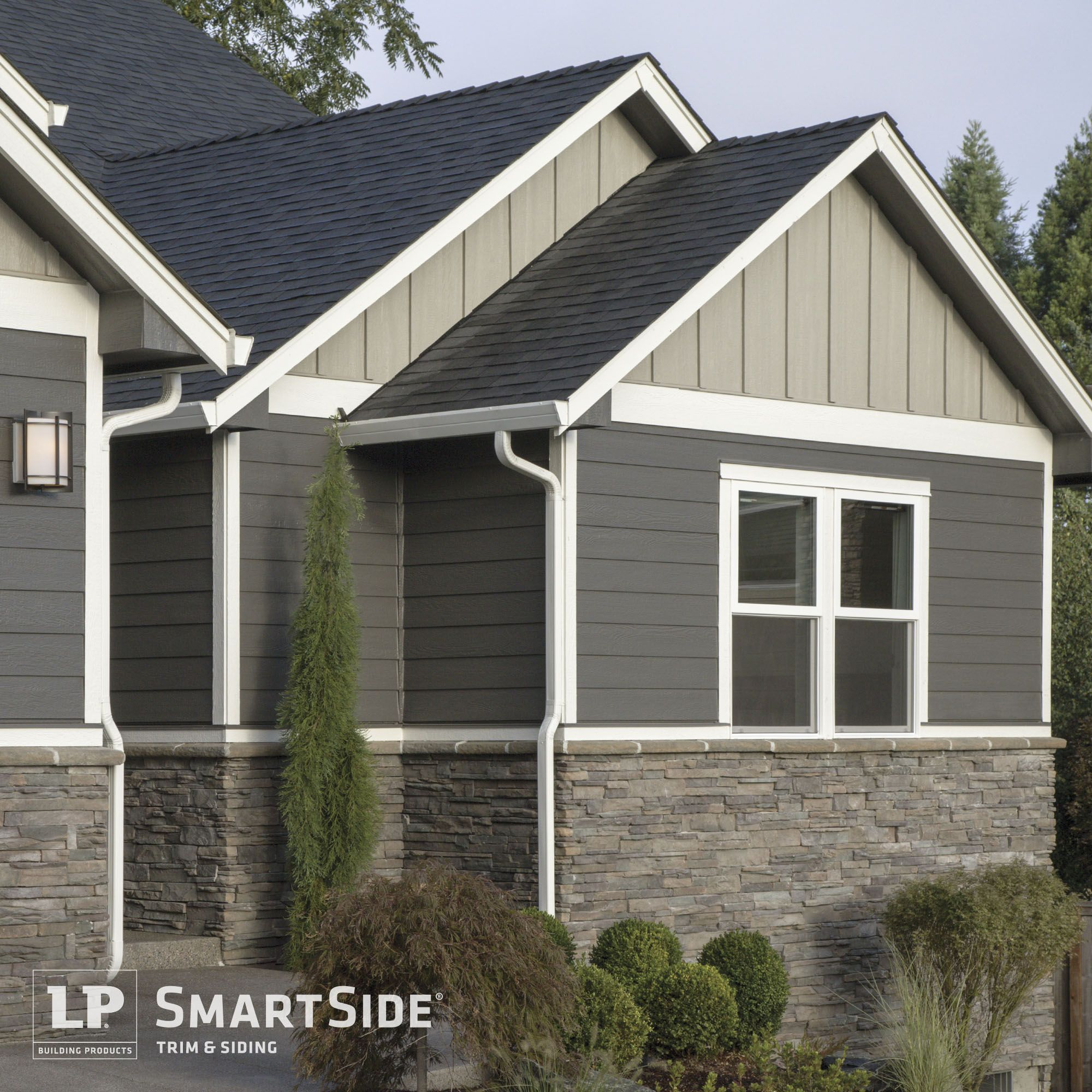 Lp Smartside Trim Lap And Panel Siding Pair With Horizontal Stonework To Create Dimension And Excitement On Cottage Exterior House Paint Exterior House Siding