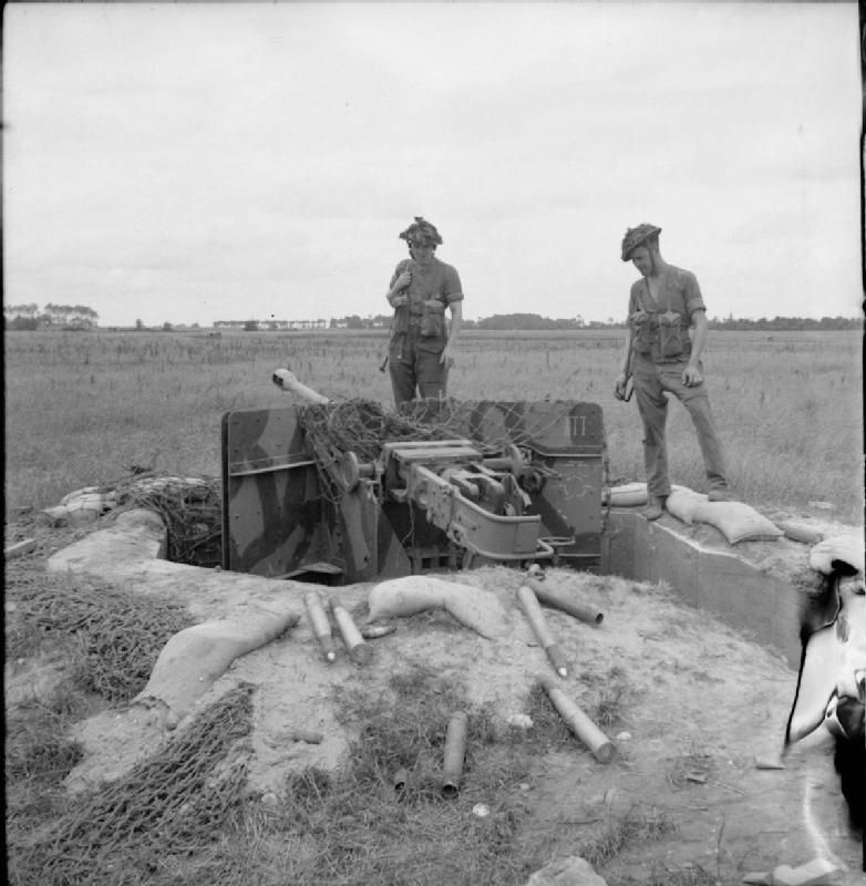 BRITISH ARMY NORMANDY 1944 (B 6315) Troops examine an abandoned German 50mm anti-tank gun position, 1 July 1944.