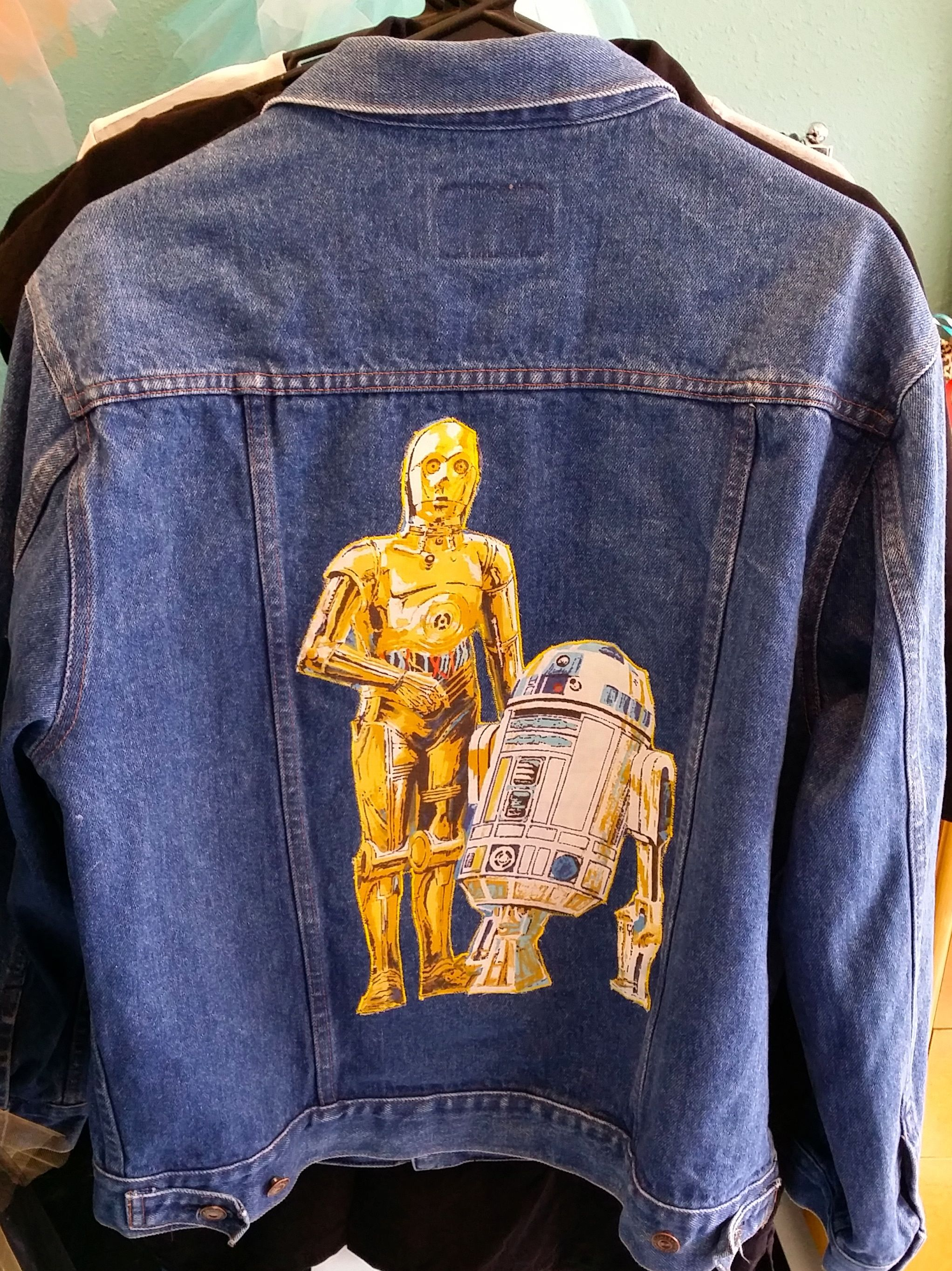 This one of a kind Star Wars Men's Medium Gap Jean Jacket is a real head turner for sure! The C3PO & R2D2 image is meticulously stitched on this medium Gap Jean Jacket. This image is vintage Star Wars. You will not find another on the street - no lameness of same.