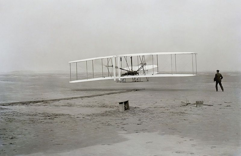 Wright brothers _ First flight of the Wright Flyer I, December 17, 1903, Orville piloting, Wilbur running at wingtip.
