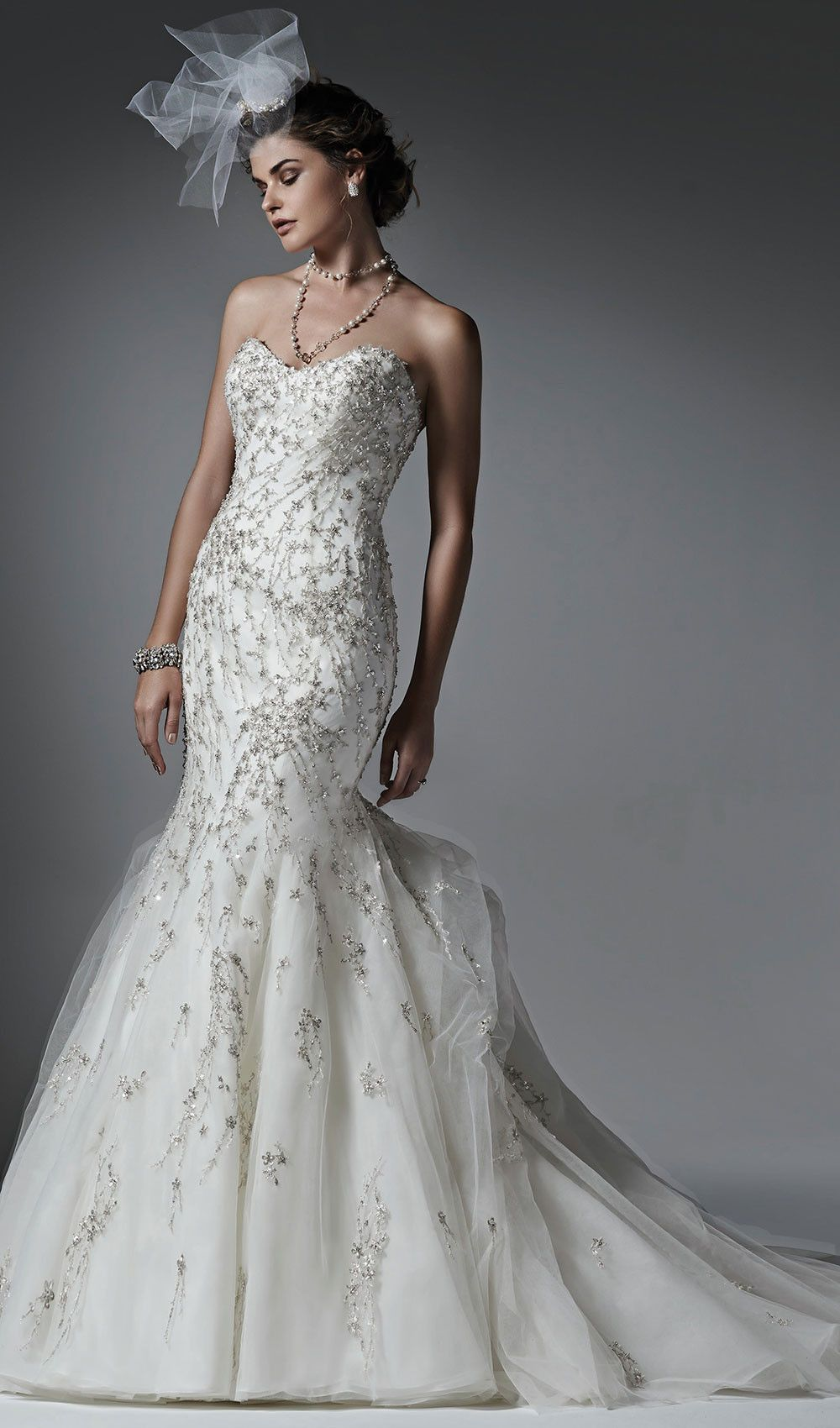 Try this tulle mermaid wedding dress, with a voluminous, ethereal skirt. Glittering Swarovski crystals and shimmering beads sprinkle the bodice. From Sottero & Midgley. Available at Schaffer's in Des Moines, Iowa. Wedding Dress Info: SOTTERO & MIDGLEY – STYLE DONALEE.