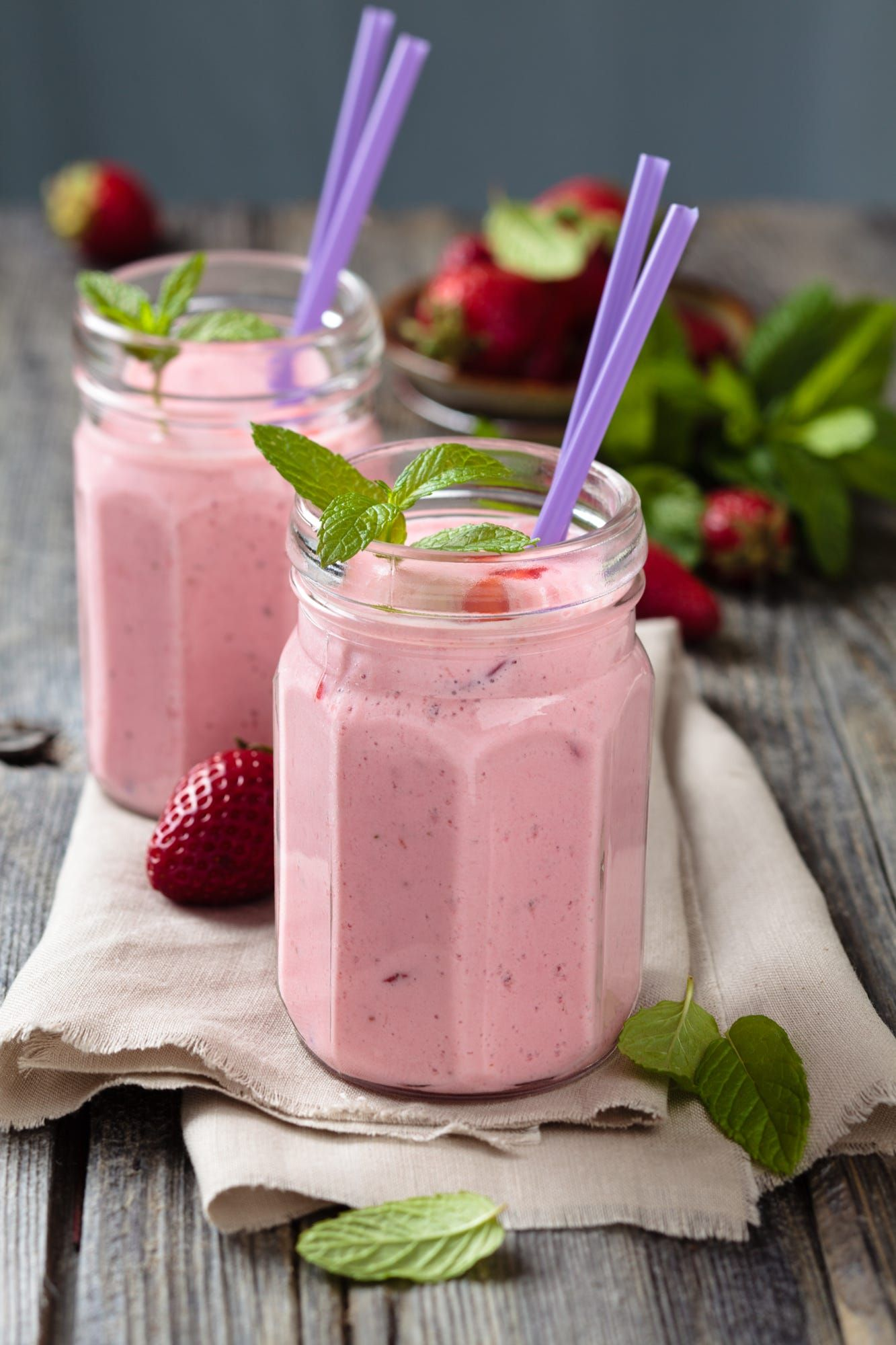 Fruit smoothie with mint leaves on wooden rustik table.