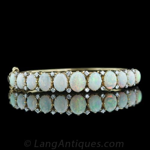 Victorian Style Opal And Diamond Bracelet Nine Graduated Opals Each Punctuated By A Pair Of Ling Rose Cut Diamonds Adorn The Top This Clic