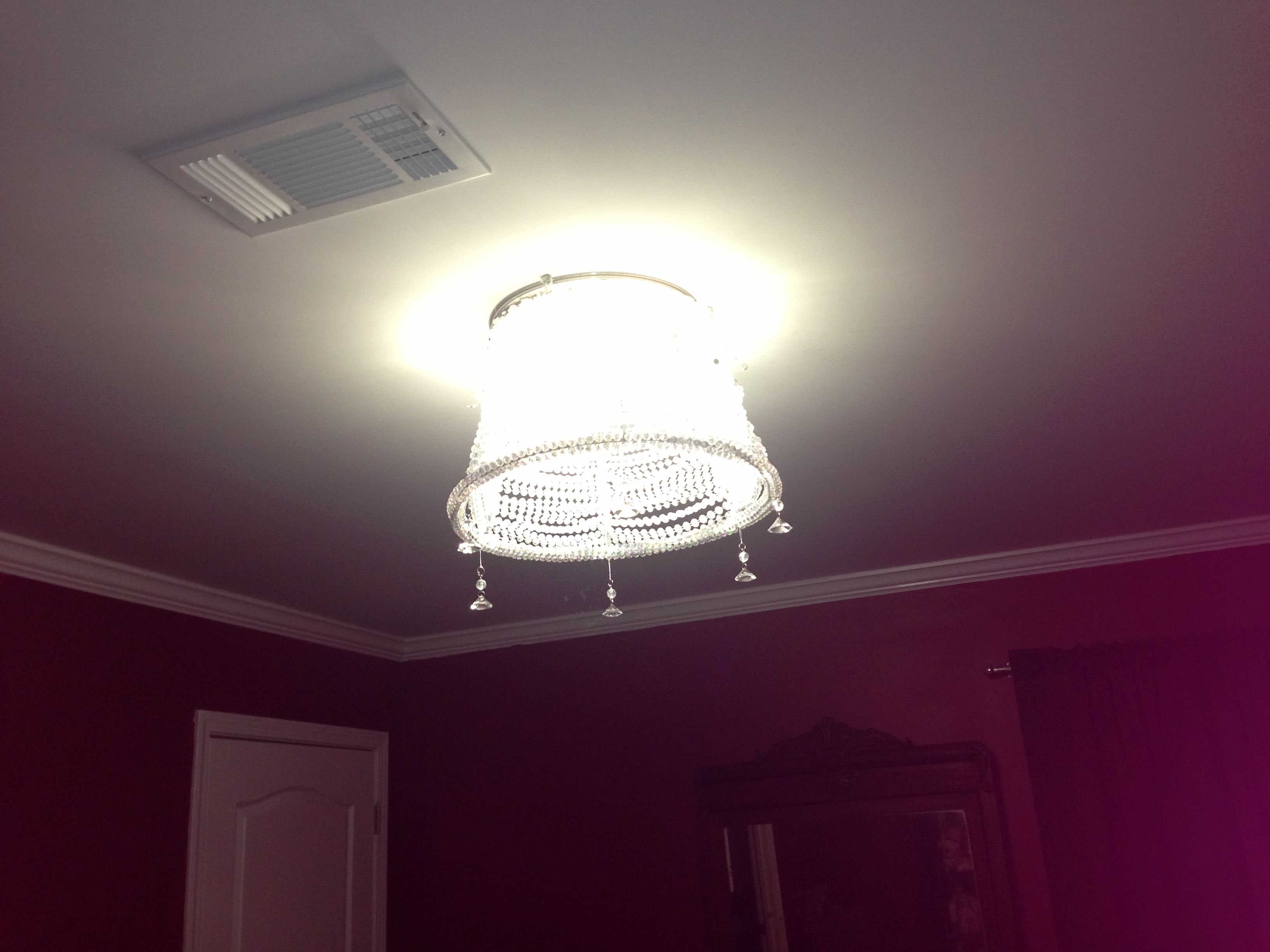 Easy chandelier made from Christmas tree beaded garland and an old lamp shade