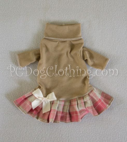 "- Adorable Turtleneck Dress with the comfort of a T Shirt - Tan colored top with a pink and tan plaid skirt - Trimmed with a cream bow - It easily pulls over the head XXXS fits 7 - 9"" chest dress leng"
