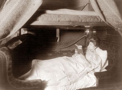 picture was taken in 1905, and the woman is relaxing in a Pullman berth on a train.