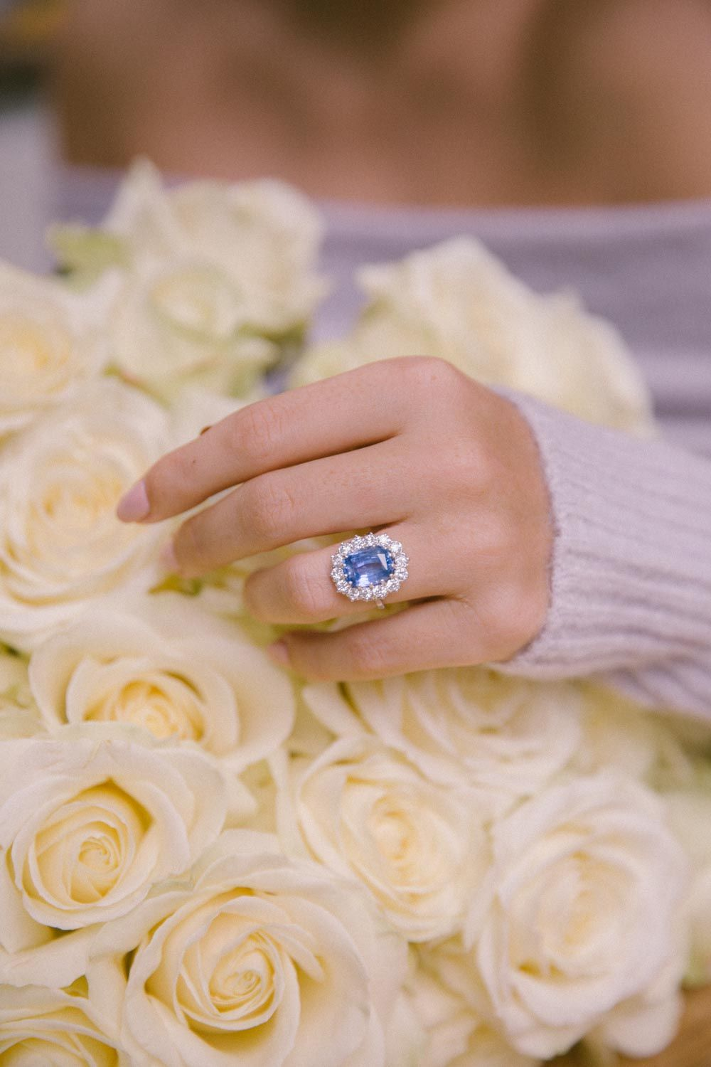 A Pale Blue Sapphire With A Cluster Of Diamonds And The Tiniest