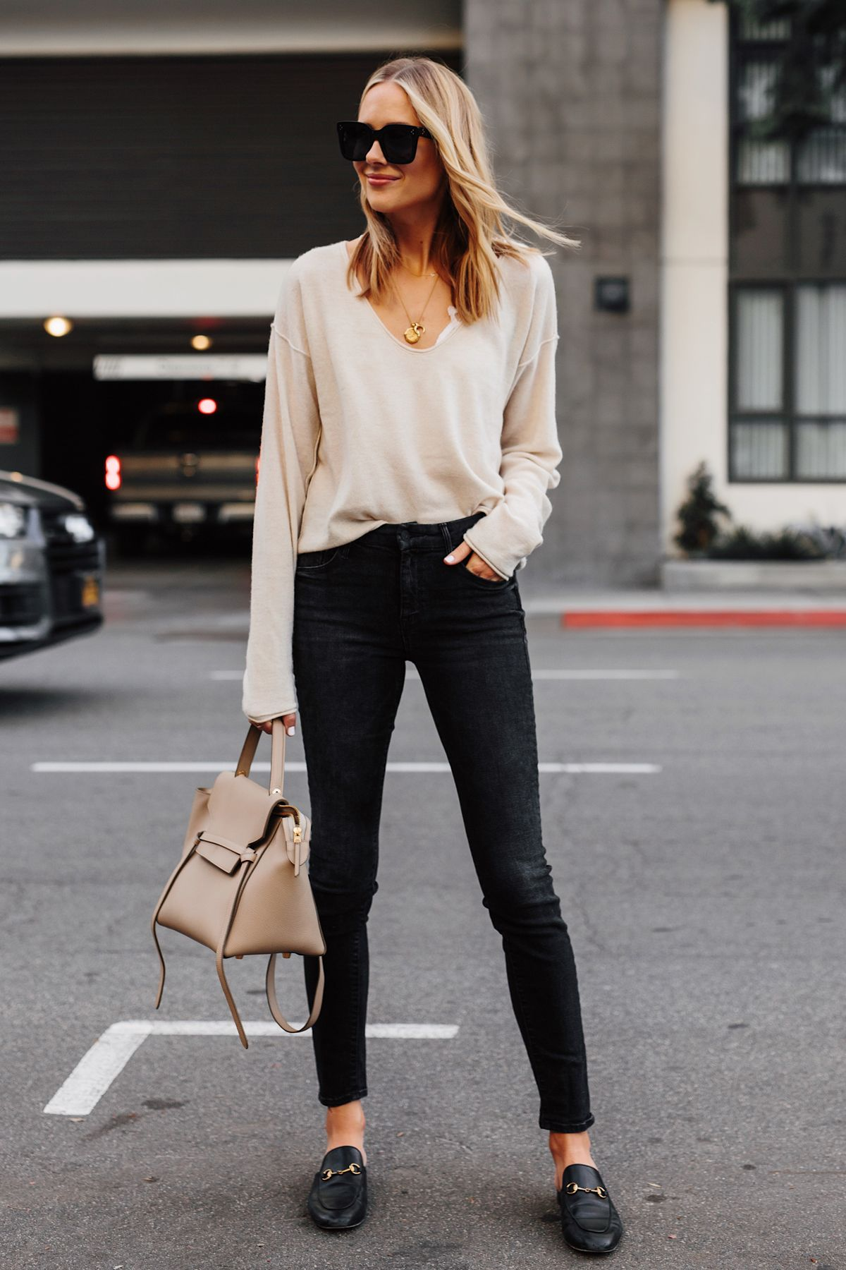 9cc85eb1c398 Blonde Woman Wearing Beige Sweater Black Skinny Jeans Gucci Princetown  Black Mules Celine Mini Belt Bag Fashion Jackson San Diego Fashion Blogger  Street ...