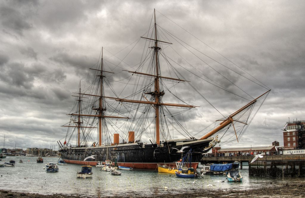 """HMS Warrior This is the Super Weapon of the 1860's and was the first iron hulled Warship. She has a steam engine and sails. I went to the Historic Dockyard in Portsmouth today, and for some reason EVERY time I go there the weather is dull and horrible .. like today. At least I can get """"atmospheric"""" shots LOL! OM-D E-M5"""