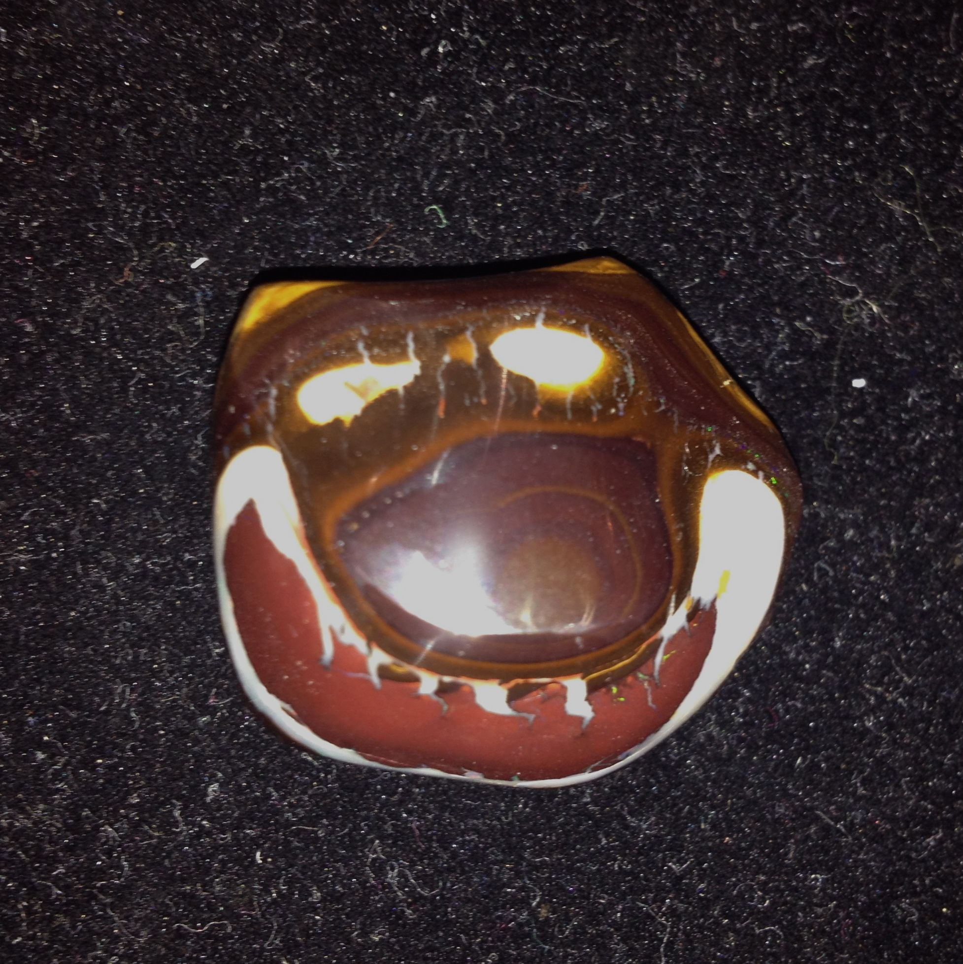 Ha!  A boulder opal picture stone from Yowah....A laughing Yogi the Bear!  Bill Kasso