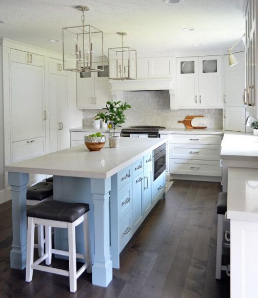 Photo of Kitchen with narrow and long island. White kitchen with a long and narrow kitche…