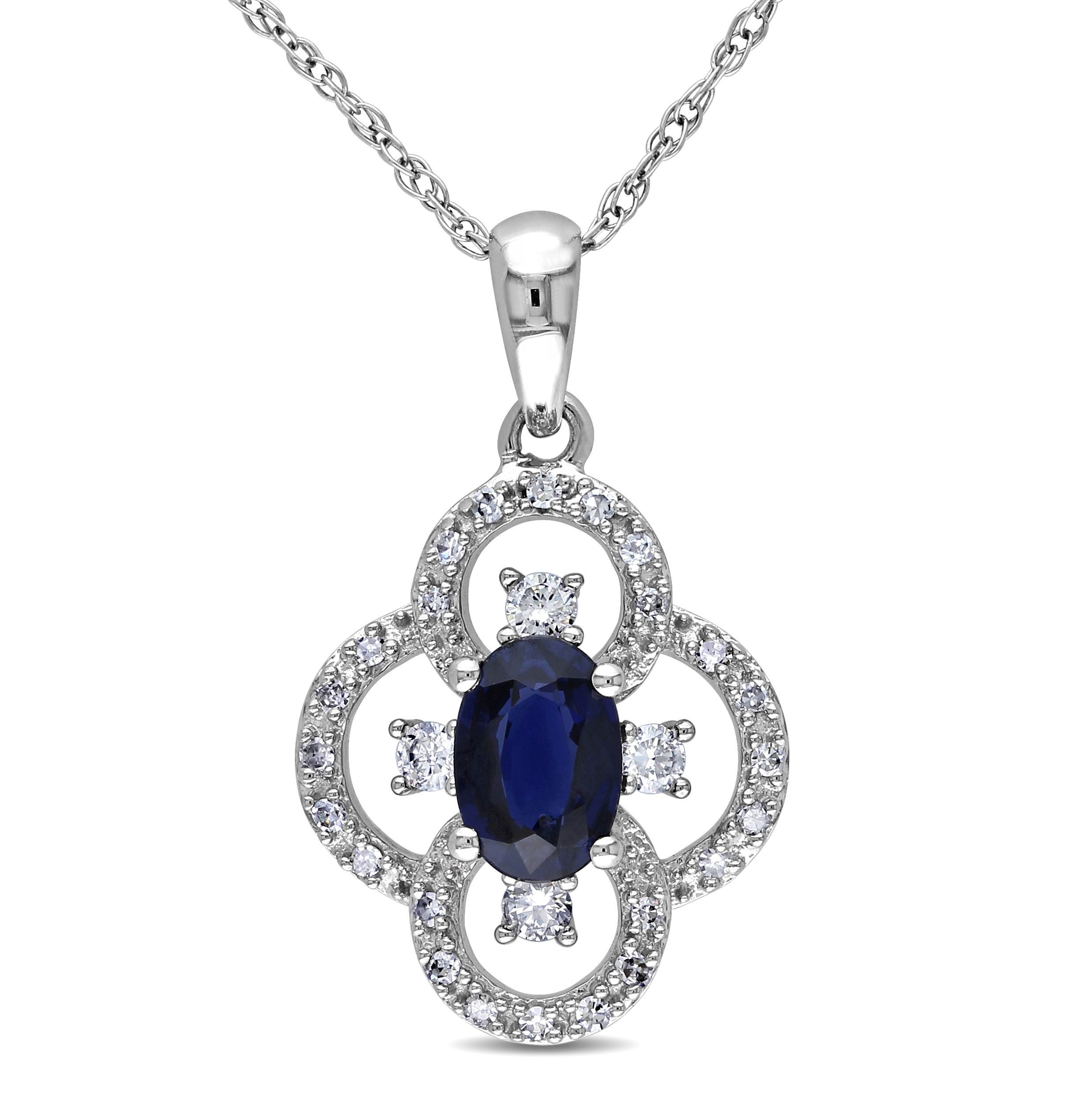 This lovely necklace from the miadora gemstones collection this lovely necklace from the miadora gemstones collection features an oval cut sapphire surrounded by a clover shape of white diamonds aloadofball Image collections