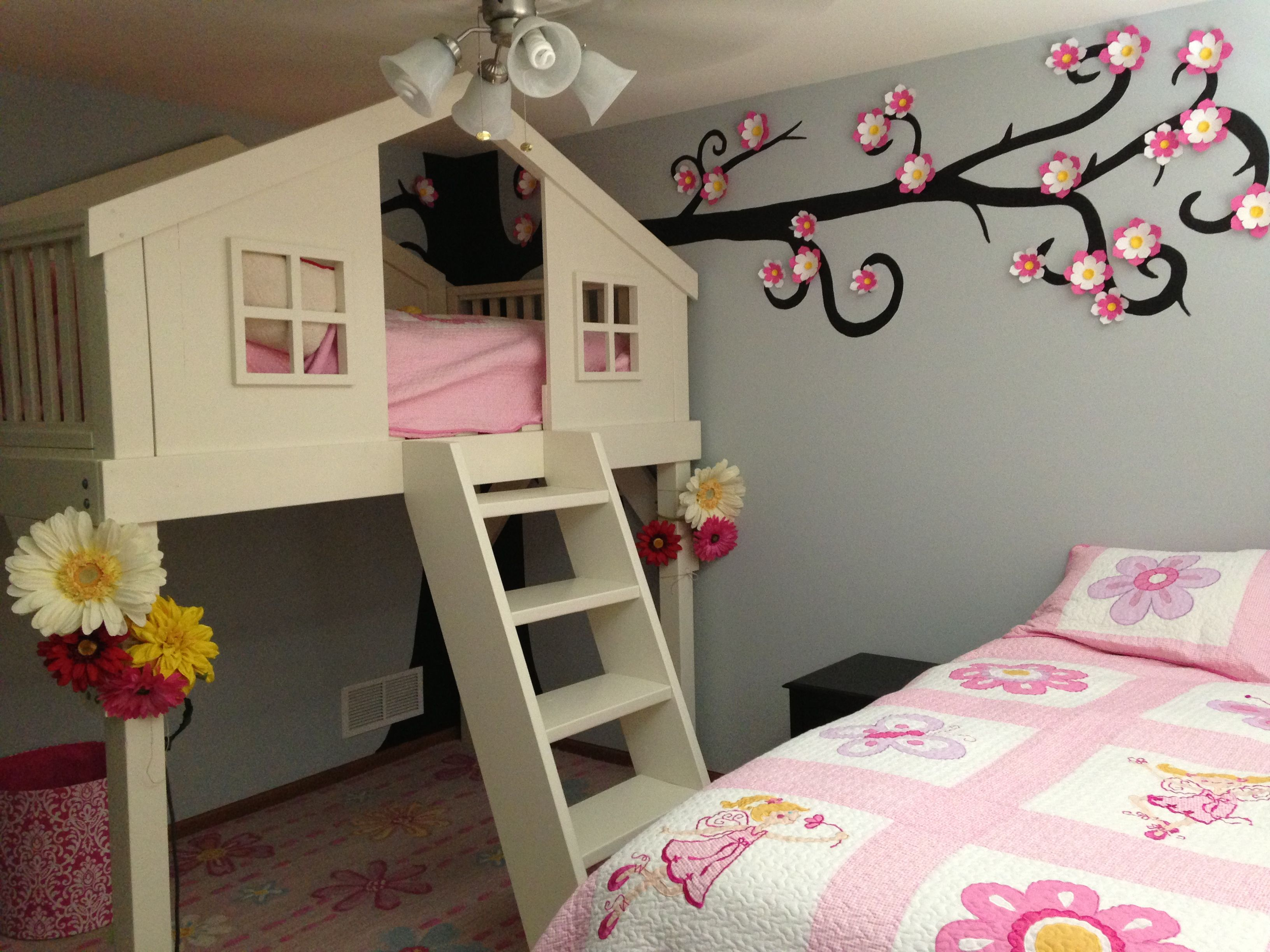 This is my daughters treehouse bedroom. We made the bed
