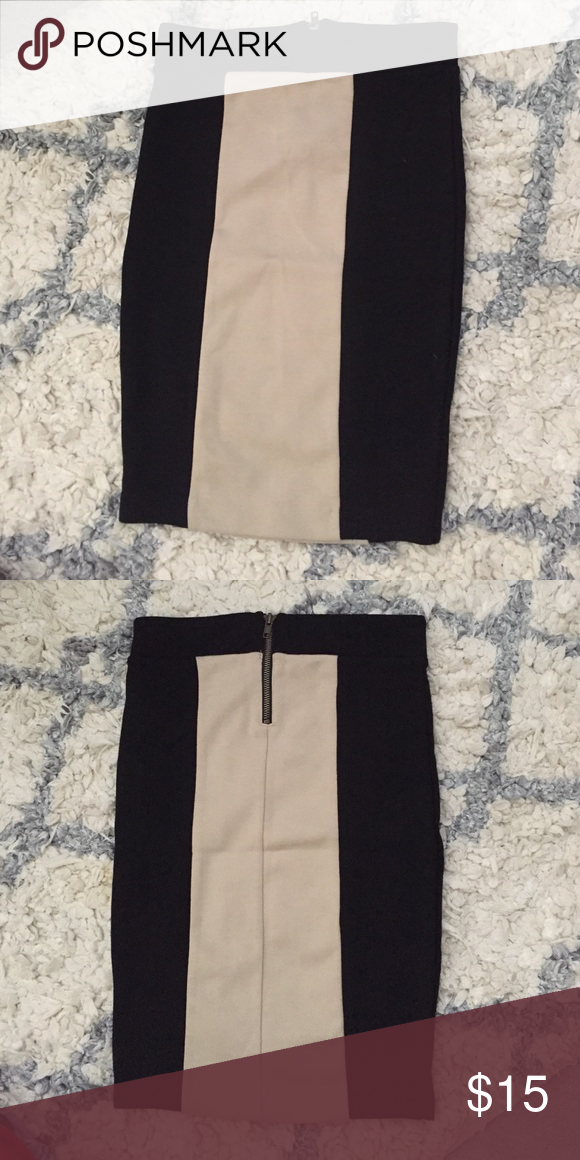 Long color block pencil skirt Never worn, very stretchy and comfortable, zipper on the back, black and light tan, 70% polyester 25% rayon 5% spandex Forever 21 Skirts Pencil